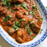 Rogan Josh Curry garnished with chopped cilantro