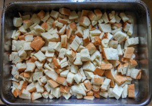 white bread pieces in an oven tray