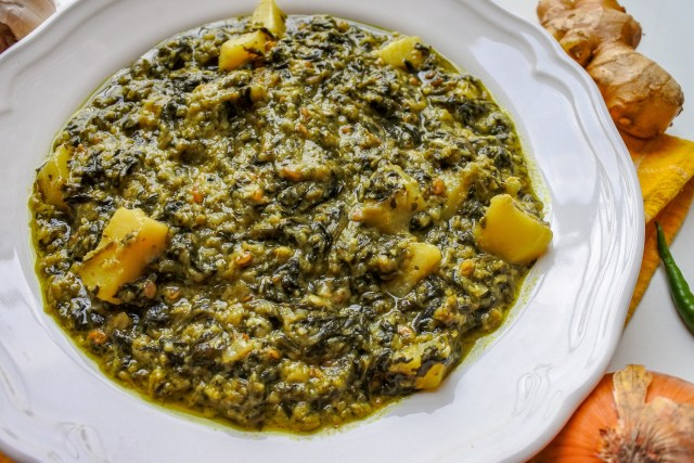 A bowl of spinach and potato curry