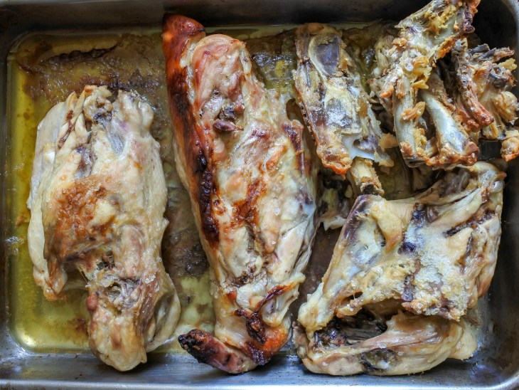 roasted chicken carcasses in a baking pan