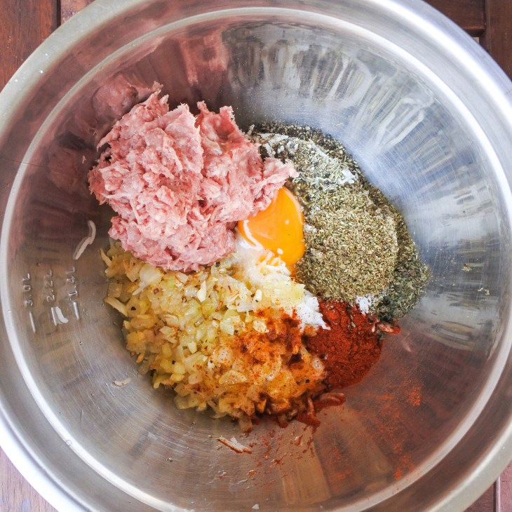 lamb, rice, onions, spices and egg in a mixing bowl