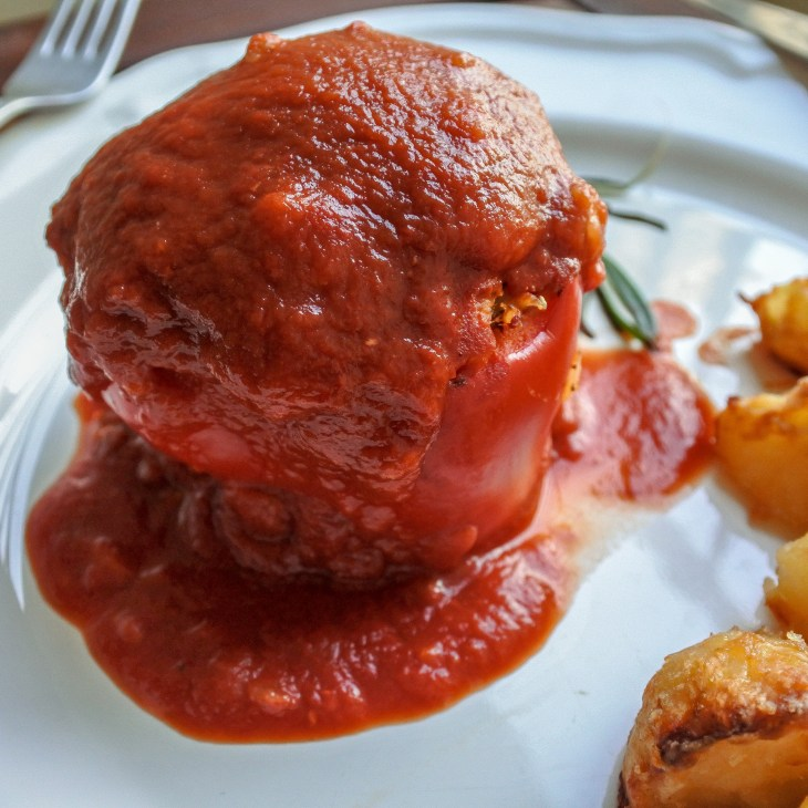 lamb stuffed red bell pepper smothered in tomato sauce