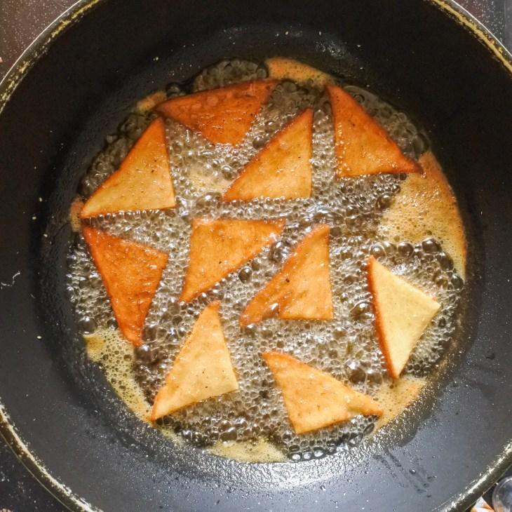 bread frying in hot oil