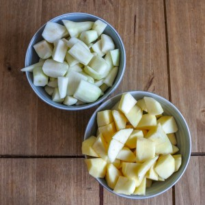 chopped up apples and pears in bowls