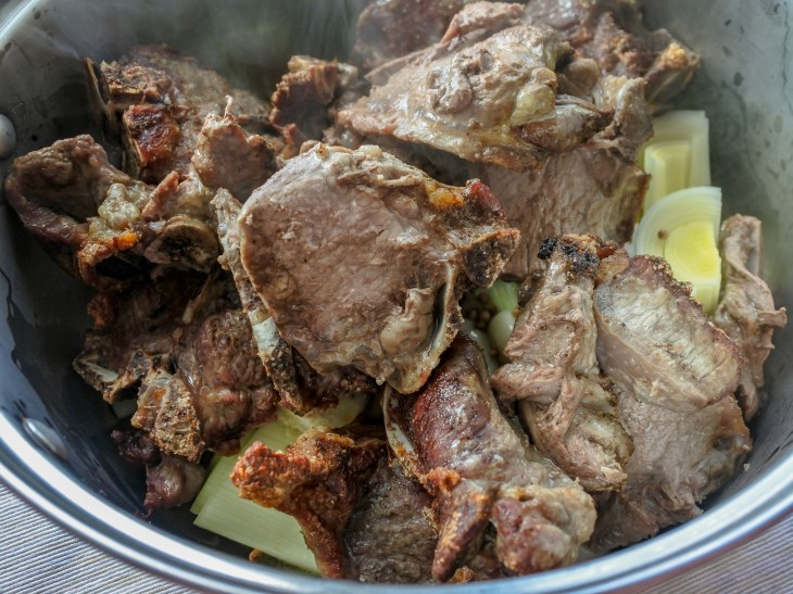 roasted lamb in a pot with vegetables