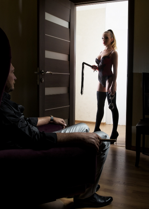 Femdom with a whip and handcuffs