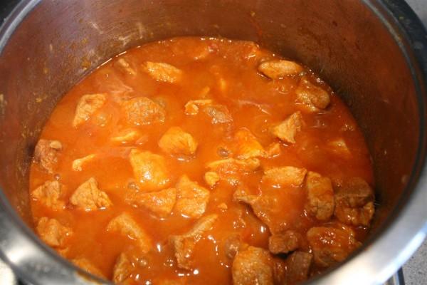 Cook the porkolt until meat becomes tender