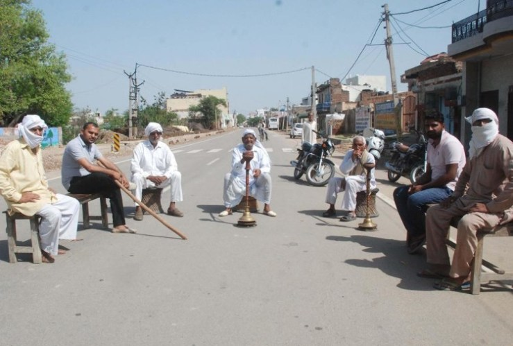 Villagers guarding outside