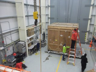 Inside the high bay, starting to uncrate.