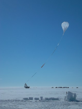 Balloon rises, along with the undeployed parachute between it and the payload.