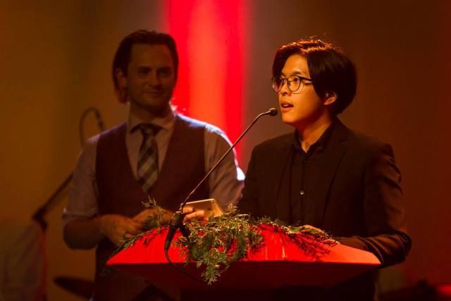 Milton Lim speaking into a mic at a podium.