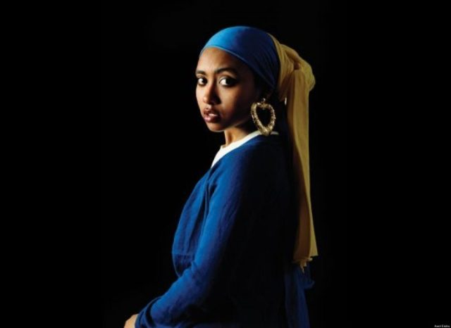 Young black woman in simple midevil clothing, looking over her shoulder.