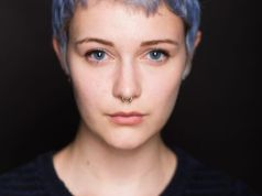 Rhiannon's headshot. Blue hair!