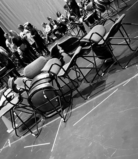 Photo of chairs, some with people in them, taken by Brad Rothbart.