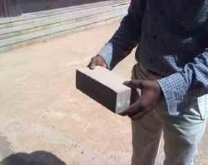Geopolymer concrete brick