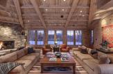 structures are clad in rustic bleached cedar timbers and native stone with beamed ceilings.