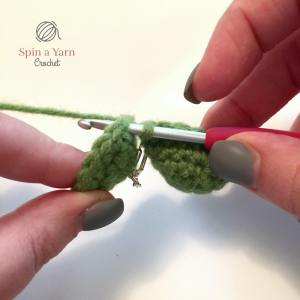 Attaching two green crochet tips together.