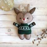 Reindeer wearing green sweater with gold