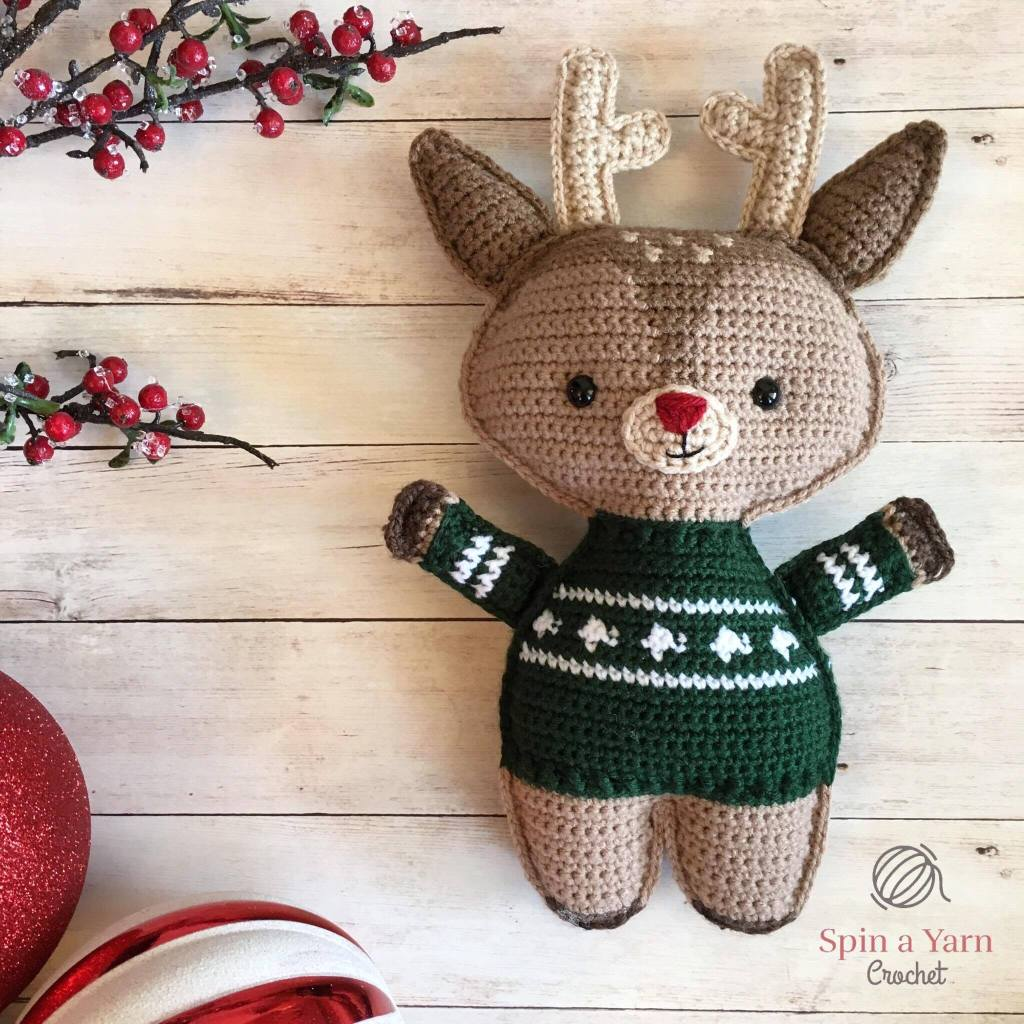 Reindeer in green sweater