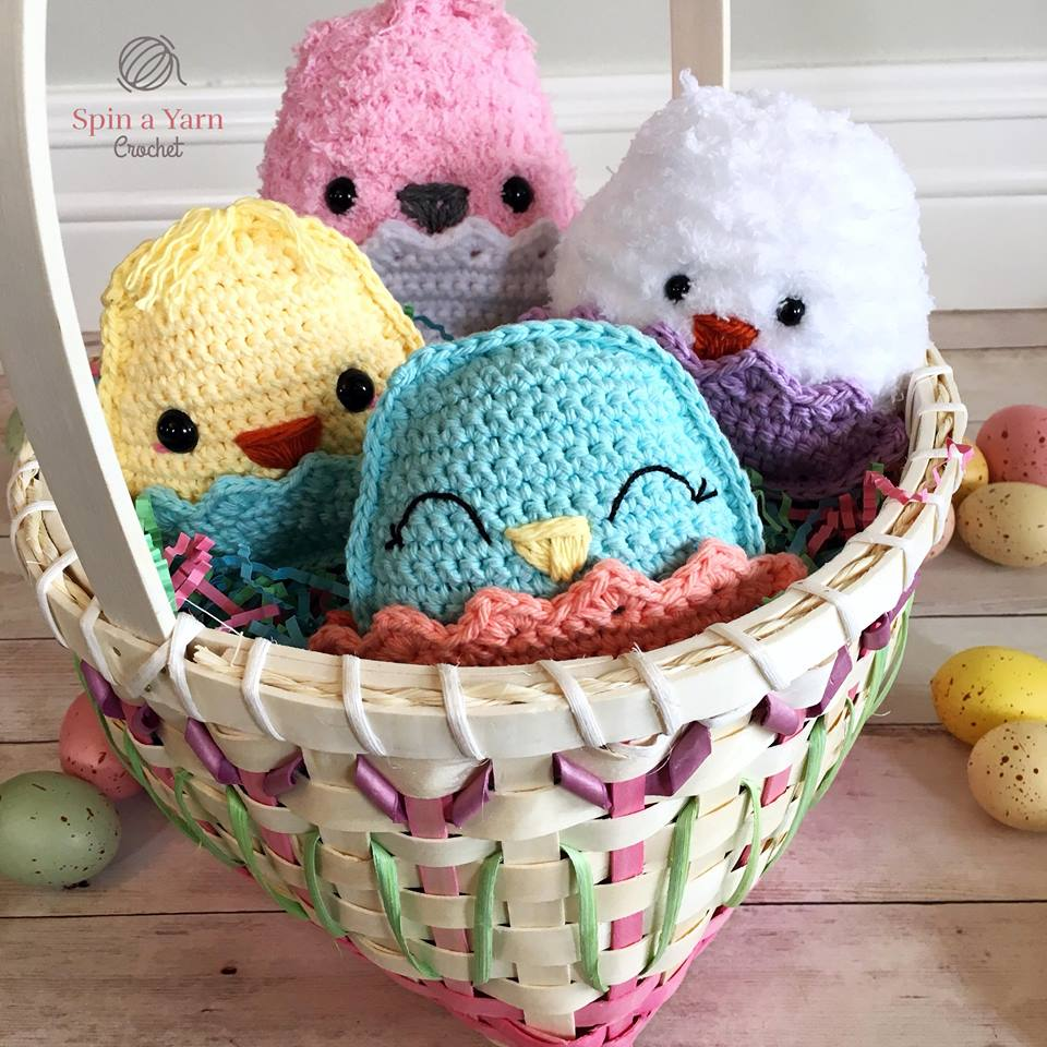 Four chubby crochet chicks in a basket