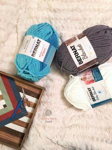 Three skeins of Bernat Blanket Yarn