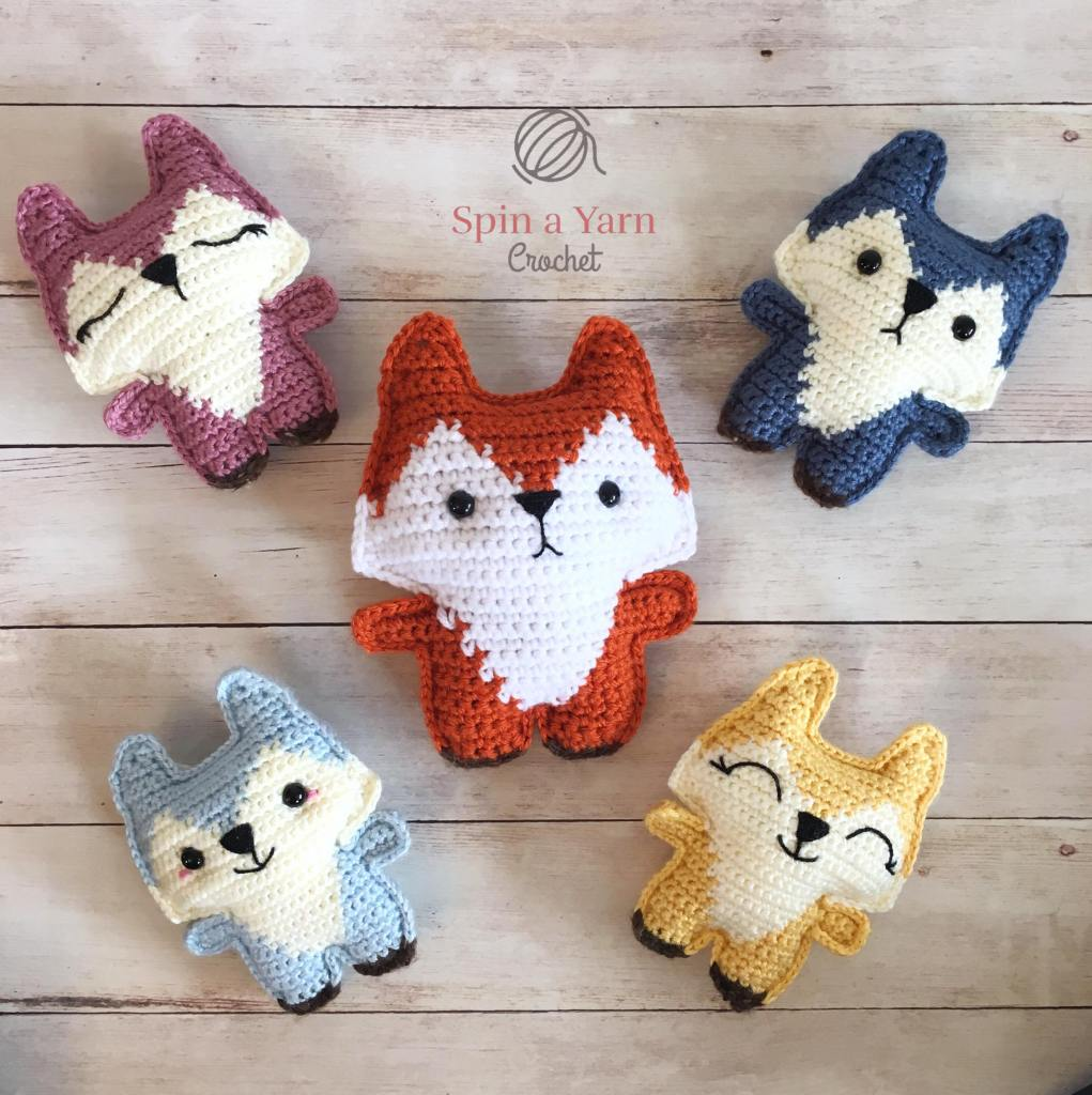 Five different coloured foxes