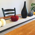 Four pumpkins on table