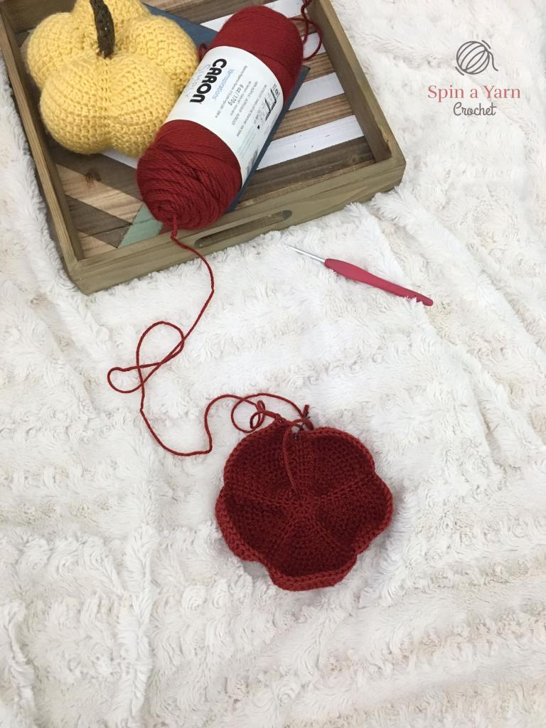 Partially crocheted red pumpkin