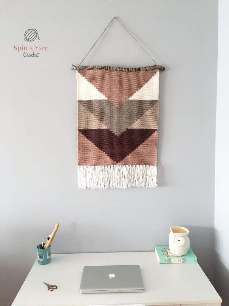Wall hanging over desk