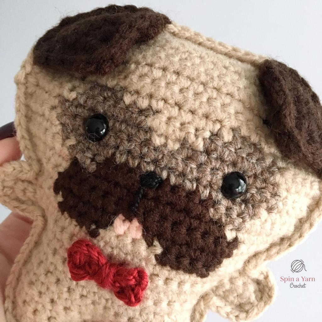 Close up of crochet pug