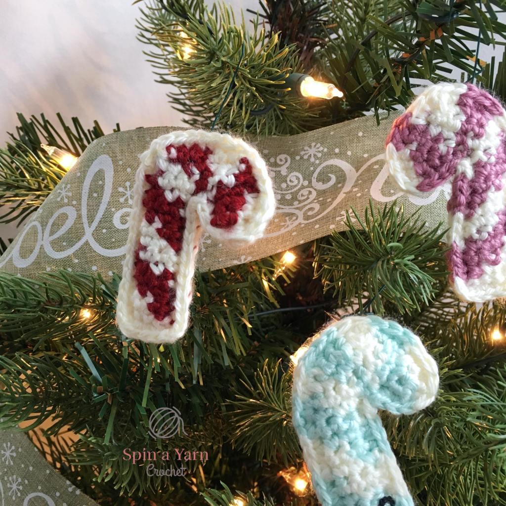Three crochet candy canes on tree