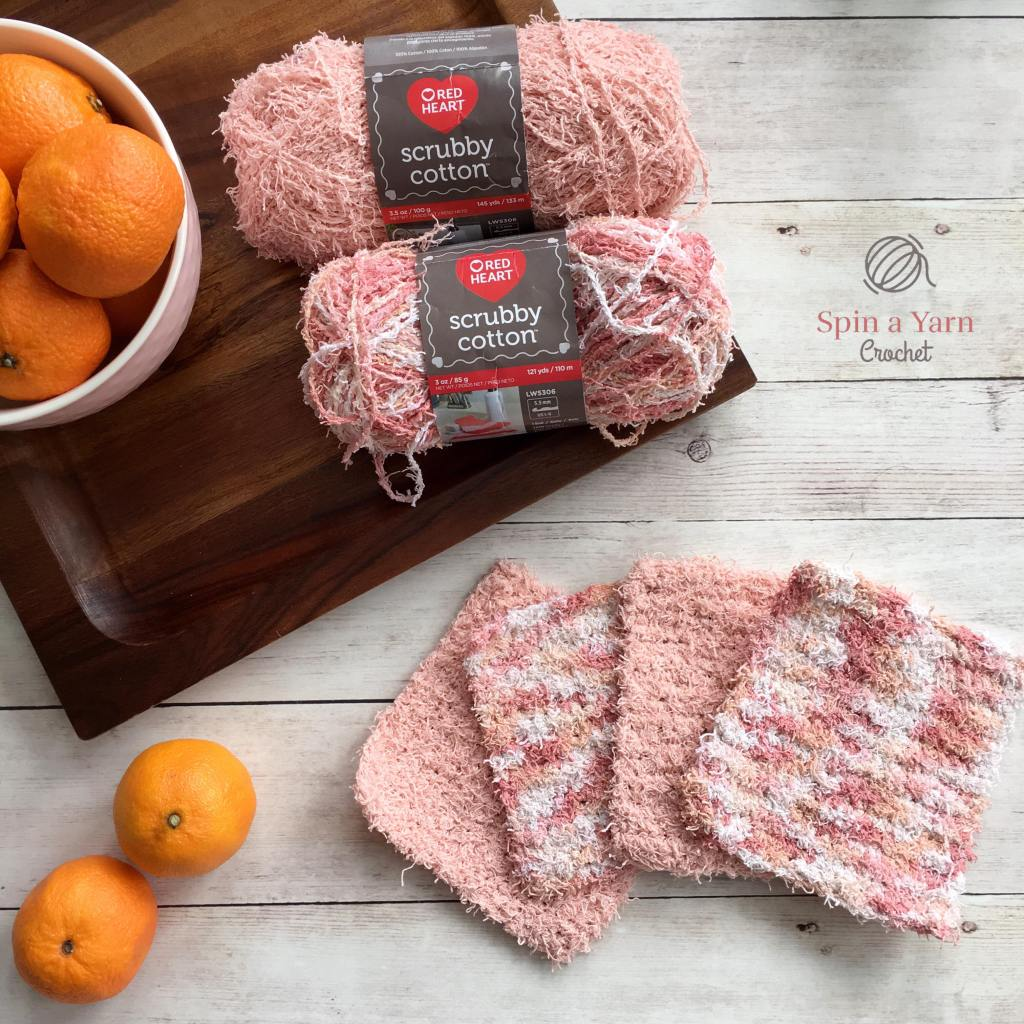 Four dish scrubbies with skeins of yarn