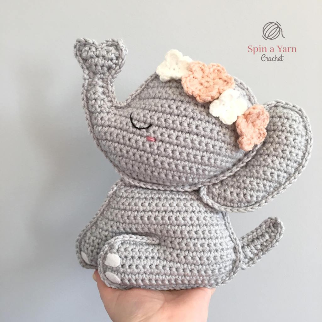 Crocheted elephant in hand