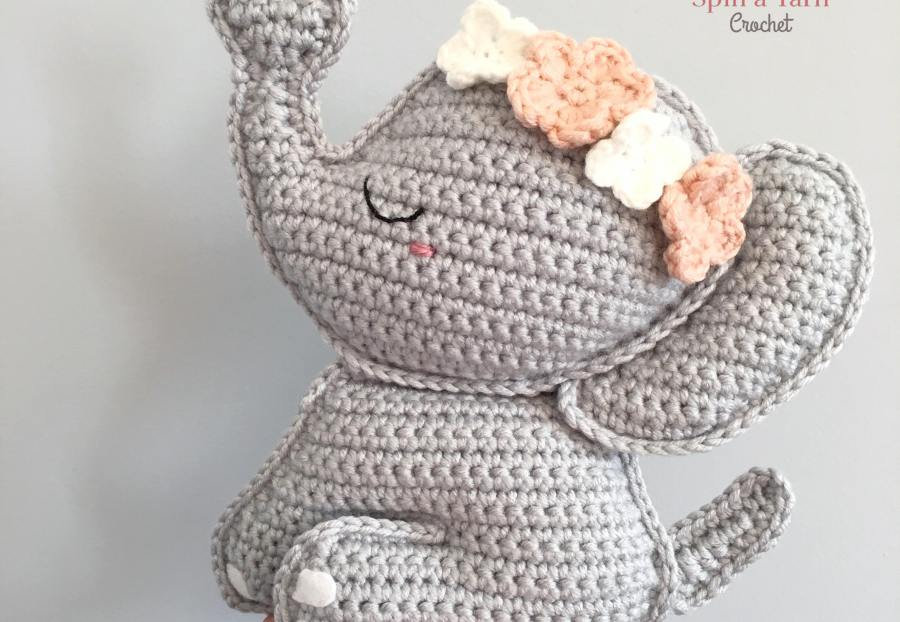Crocheted elephant in hand