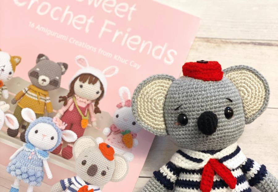 Crochet koala and book