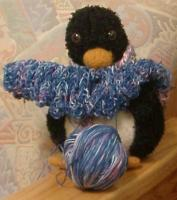 Nancy\'s penguin helping to knit the Siobhan