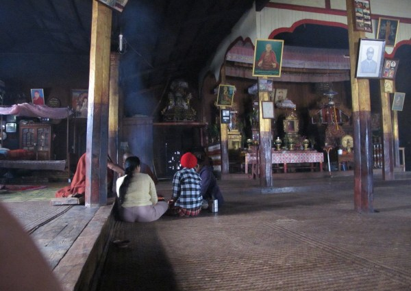 Myanmar trek temple, monk visited by villagers