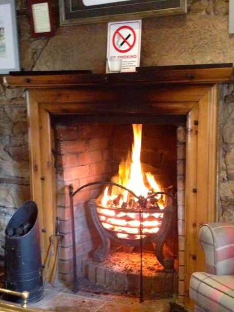 a warm coal fire in an out-of-the-way inn