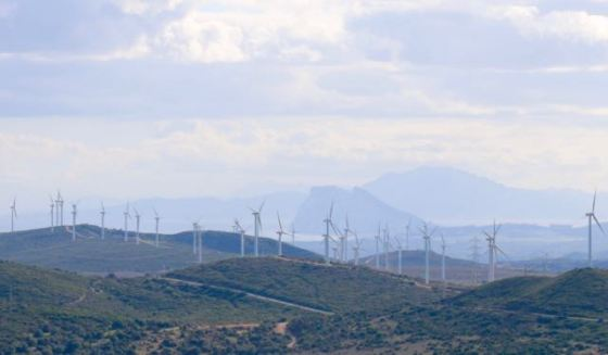 Recognize the profile of the Rock just behind the wind turbines? The mountains behind it are in Morocco.
