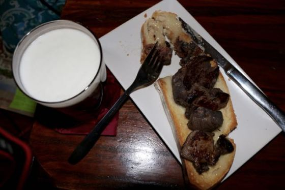 jabalí (wild boar) on toast with melted local cheese