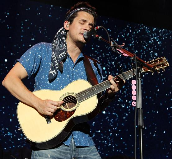 John Mayer channels Jimi Hendrix with a head scarf and a guitar