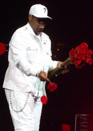 Boyz II Men's Nate Morris hands out roses to the crowd