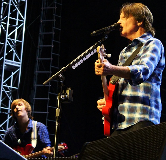 Shane Fogerty, L, plays guitar on tour with dad.