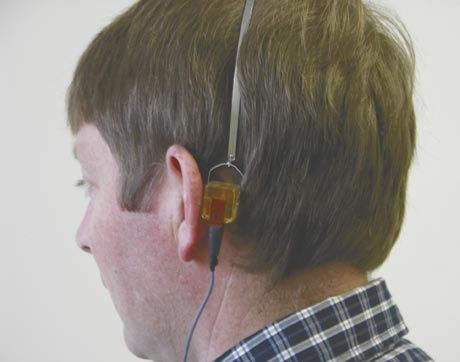 A man wearing hearing test equipment