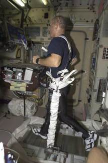 Astronaut Ken Bowersox runs on a treadmill using a loading harness.