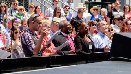 Presiding Bishop Michael Curry joining in with the hymns before preaching about the Jesus Movement at Kansas City Live! Image credit: Gary Allman