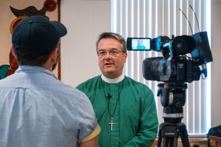 Fr. Brian McVey, Church of the Advent, Nashville, is interviewed by the by the Springfield media during the Human Trafficking workshop. Image credit: Gary Allman