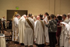 Laying on of Hands. Kary Mann and Larry Ehren are Ordained into the Sacred Order of Deacons Image credit: Gary Zumwalt