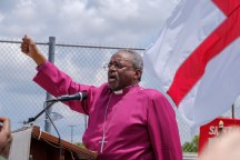 Presiding Bishop Micheal Curry addresses the people from General Convention at Prayers for Justice outside the T. Don Hutto Residential Center. Image: Gary Allman