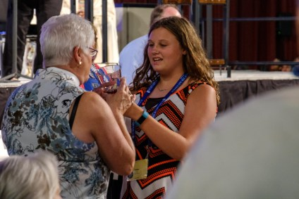 Tatum Trader serving communion wine at the General Convention Closing Eucharist. Image: Gary Allman